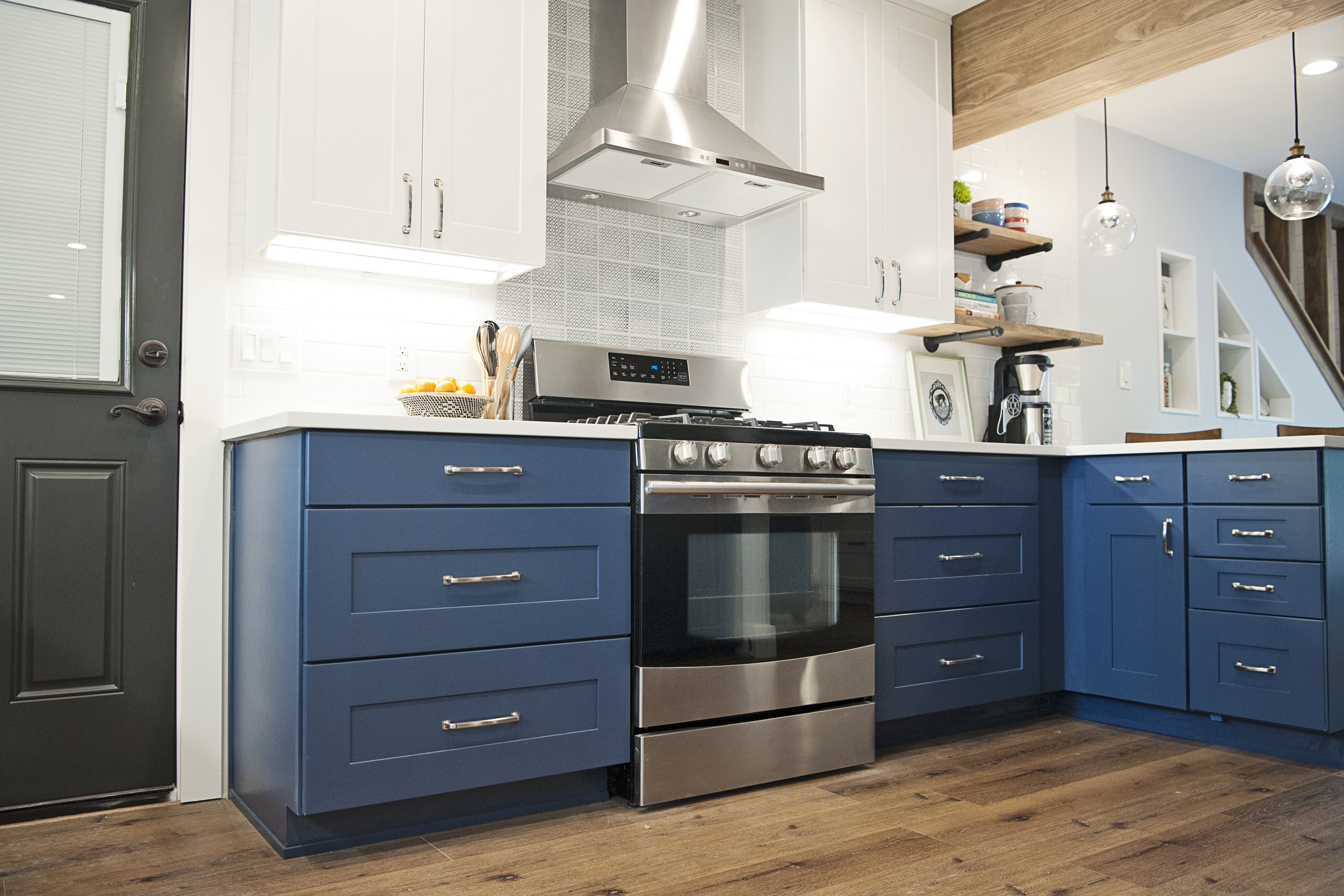 Trend Alert: Blue Kitchen Cabinets | Wolf Home Products on blue white yellow kitchen, blue kitchen hutches, blue country kitchens, blue green gray kitchen, blue kitchen countertops, blue kitchen colors, blue kitchen tile, blue kitchen bench, blue kitchen ceilings, blue and green kitchen, blue kitchen island, blue italian kitchen, blue kitchen wallpaper, blue kitchen remodel, blue kitchen walls, blue kitchen pulls, blue and white kitchen ideas, blue floor cabinets, blue pantry cabinet, blue kitchen room ideas,