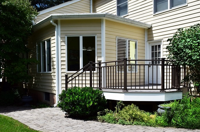 Wolf Serenity Decking in Silver Teak feat. Westbury Railing in Bronze Fine Texture & Outdoor Lighting in Textured Black