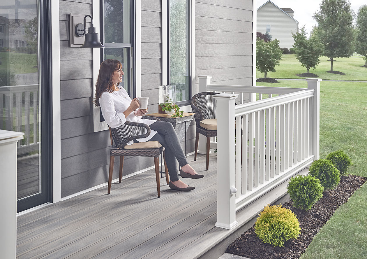 Woman Sitting On PVC Deck in Backyard