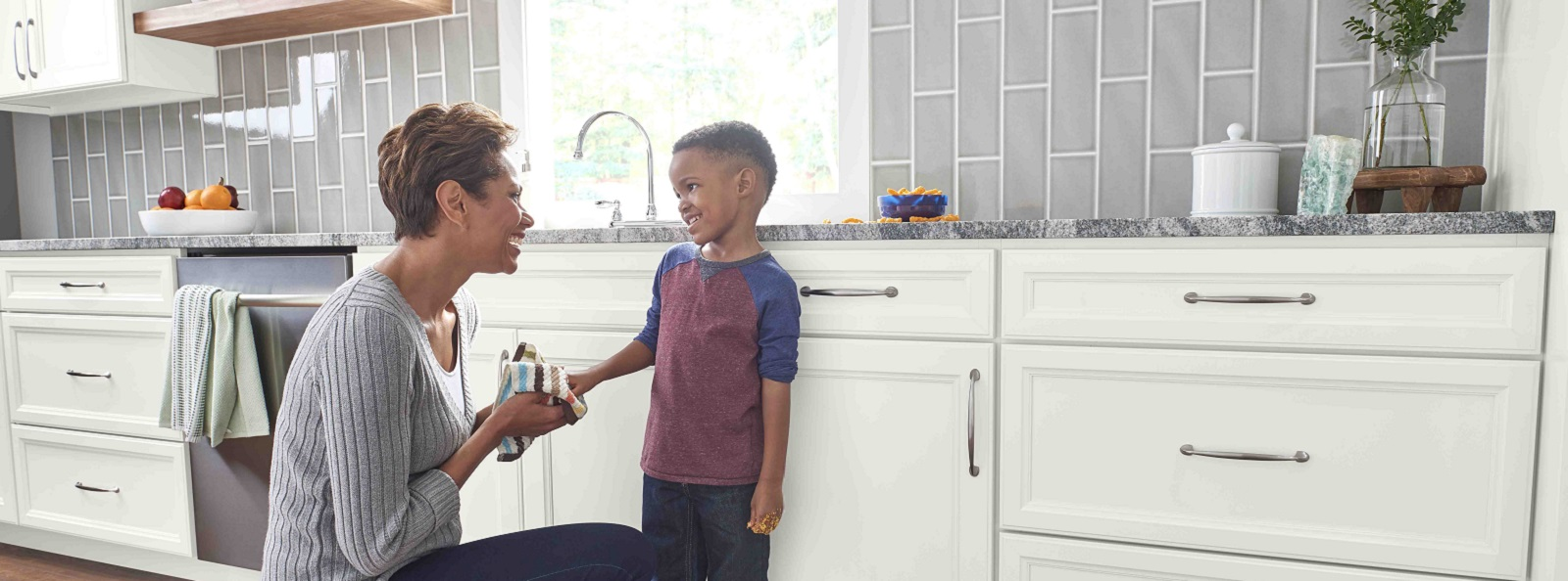 Mother and Child in Kitchen with Livingston Arctic White Cabinets