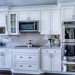 WOLF Designer Cabinets in Sullivan Maple, White with Black Glaze