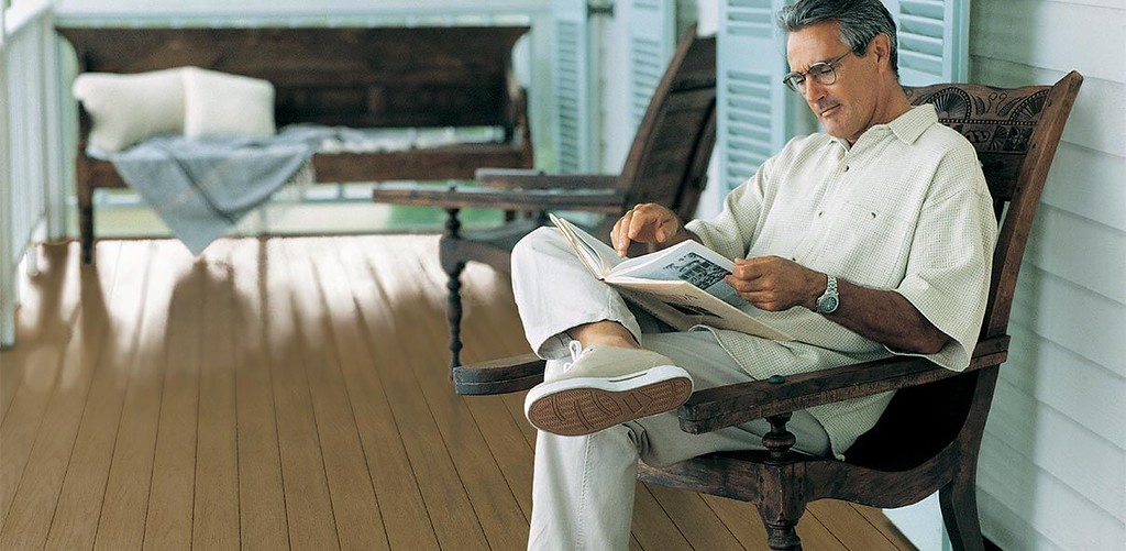 Man Reading on PVC Porch Flooring
