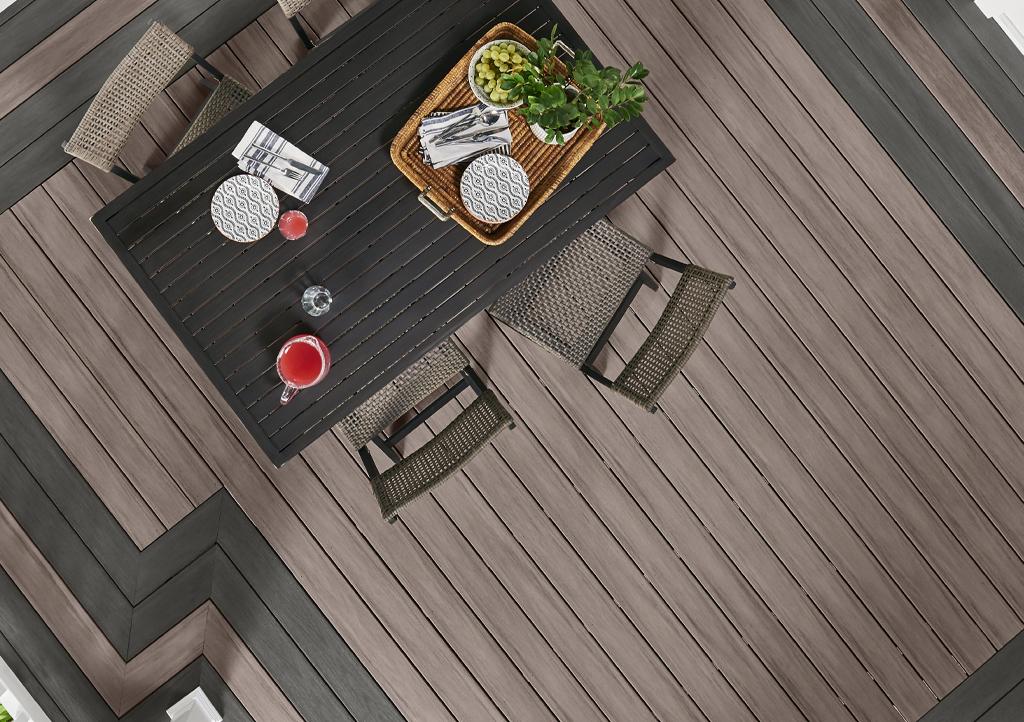 Woman Sitting On PVC Deck in Backyard